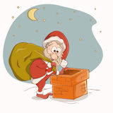 Santa Claus going down the chimney Royalty Free Stock Image