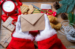 Santa Claus got a Christmas letter. On wooden background Stock Images