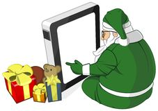 Santa Claus in Green Costume Uses Tablet PC Vector Stock Photography