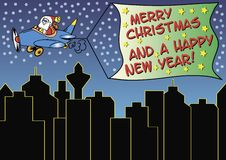 Santa claus is greeting. Santa claus in a plane over the city, dragging a banner with christmas and new year greetings. Available as Illustrator-file Stock Photography