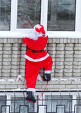 Santa Claus - grimpeuse Photographie stock libre de droits