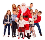Santa Claus with a group of children Stock Images