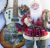 Santa Claus and guitar Royalty Free Stock Photo