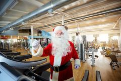 Santa Claus in the gym doing exercises Royalty Free Stock Photos
