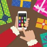 Santa Claus-Hände, die Geschenke senden Lizenzfreie Stockfotos
