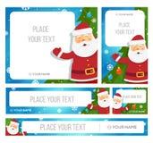 Santa Claus hållbaner med julhälsningar Arkivbilder