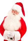 Santa Claus ha una grande bella barba sui precedenti bianchi Immagine Stock