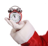Santa Claus hand with alarm clock. Stock Photo