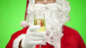 Santa Claus hand with a glass of champagne. close up. chroma key