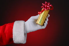 Santa Claus Hand Holding Present Royalty Free Stock Photo