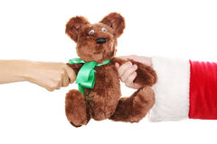 Santa Claus hand holding toy bear Stock Image