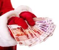 Santa Claus-hand met geld (Russische roebel). Royalty-vrije Stock Foto's