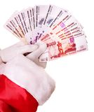 Santa Claus hand with  money Russian rouble. Stock Photo