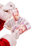 Santa Claus hand with  money (Russian rouble). Stock Photography