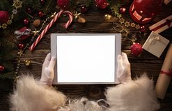 Santa Claus hands holding blank digital tablet stock photography