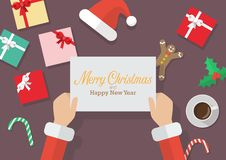 Santa Claus hands holding a Merry Christmas and Happy new year s vector illustration