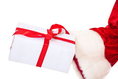 Santa Claus hands over present Stock Photos