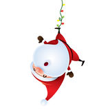 Santa Claus hanging upside down Royalty Free Stock Photography