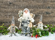Santa Claus and happy kids in snow. Christmas decoration Royalty Free Stock Images