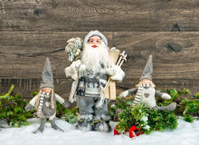 Santa Claus and happy kids in snow. Christmas decoration Stock Image