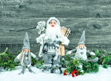 Santa Claus and happy kids in snow. Christmas decoration Royalty Free Stock Photo