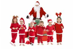 Santa Claus with happy little children in costume Stock Images