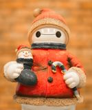 Santa claus happy statue holding a smiling child Royalty Free Stock Image