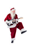 Santa Claus has fun with a guitar Stock Photo