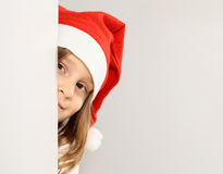 Santa claus hat. Little girl in the santa claus hat Stock Photos