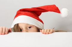 Santa claus hat. Little girl in the santa claus hat Royalty Free Stock Image