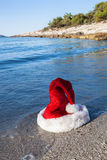 Santa Claus hat on the beach Royalty Free Stock Images
