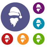 Santa Claus hat and beard icons set. In flat circle reb, blue and green color for web Stock Image