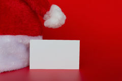 Santa Claus hat with a blank card good for test Royalty Free Stock Photo