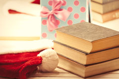 Santa Claus hat and books Royalty Free Stock Photography