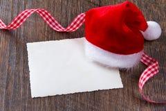 Santa Claus hat card ribbon Royalty Free Stock Images