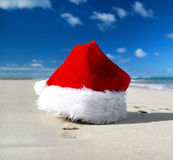 Santa claus hat on caribbean beach Royalty Free Stock Image
