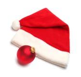 Santa claus hat and christmas ball Royalty Free Stock Photography