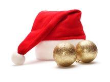 Santa claus hat and christmas ball Stock Photography