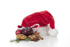 Santa Claus hat with christmas decoration against white background Stock Photo