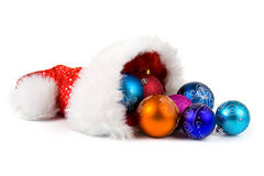 Santa Claus hat with Christmas ornaments Stock Photos