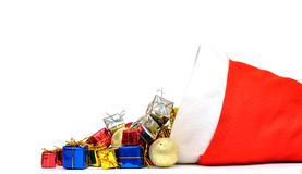 Santa Claus hat with Christmas presents Royalty Free Stock Photo