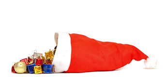 Santa Claus hat with Christmas presents Royalty Free Stock Image