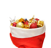 Santa Claus hat with Christmas presents Stock Photos