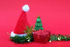 Santa claus hat with christmas tree and gift for new year and ch. Ristmas design Stock Photos