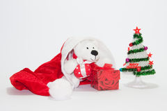 Santa Claus hat with christmas tree and gifts Royalty Free Stock Images