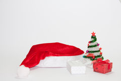 Santa Claus hat with christmas tree and gifts Royalty Free Stock Photography