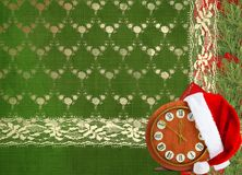 Santa Claus hat, clock and Christmas tree with Royalty Free Stock Images