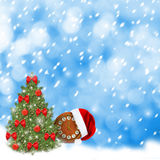 Santa Claus hat, clock and Christmas tree Royalty Free Stock Images