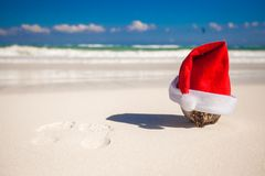 Santa Claus hat at coconut on a white sandy beach Royalty Free Stock Photos