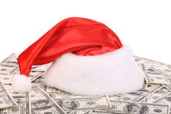 Santa Claus hat on dollar. Isolated Stock Images